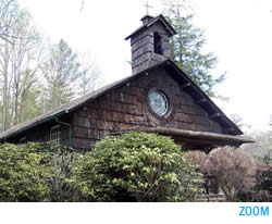 100 year old church with bark siding